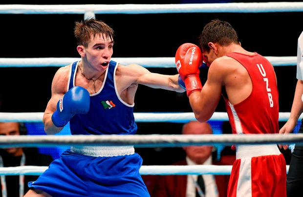 Michael Conlan lands a blow on Murodjon Akhmadaliev of Uzbekistan during their men's Bantamweight 56kg final in Doha