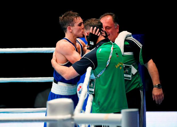Michael Conlan is embraced by Irish coach Billy Walsh after winning gold at the World Amateur Boxing Championships