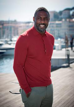 CANNES, FRANCE - APRIL 14: Idris Elba poses during the 'Mandela, My Dad And Me' photocall at MIPTV on April 14, 2015 in Cannes, France. (Photo by Didier Baverel/WireImage)