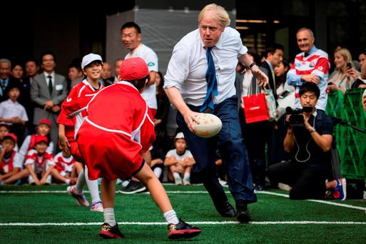 Mayor of London Boris Johnson joins a Street Rugby tournament in a Tokyo street with school children and adults from Nihonbashi, Yaesu & Kyobashi Community Associations. Stefan Rousseau/PA Wire