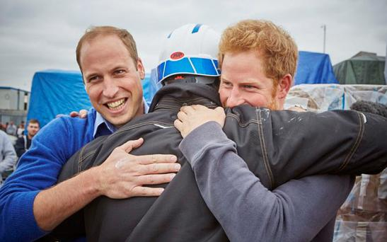 Programme Name: DIY SOS: Homes for Veterans - TX: n/a - Episode: n/a (No. n/a) - Picture Shows: (L-R) HRH Prince William, Nick Knowles, HRH Prince Harry - (C) BBC - Photographer: tbc