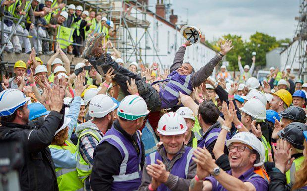Programme Name: DIY SOS: Homes for Veterans - TX: n/a - Episode: n/a (No. n/a) - Picture Shows: crowd surfs the volunteers on the build. Billy Byrne - (C) BBC - Photographer: tbc