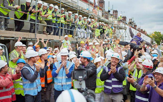 Programme Name: DIY SOS: Homes for Veterans - TX: n/a - Episode: n/a (No. n/a) - Picture Shows: The Princes join the DIY SOS team and volunteers as Billy Byrne crowd surfs. HRH Prince William, HRH Prince Harry - (C) BBC - Photographer: tbc