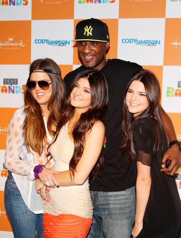 (L-R) Khloe Kardashian, Lamar Odom, Kylie Jenner and Kendall Jenner in 2012