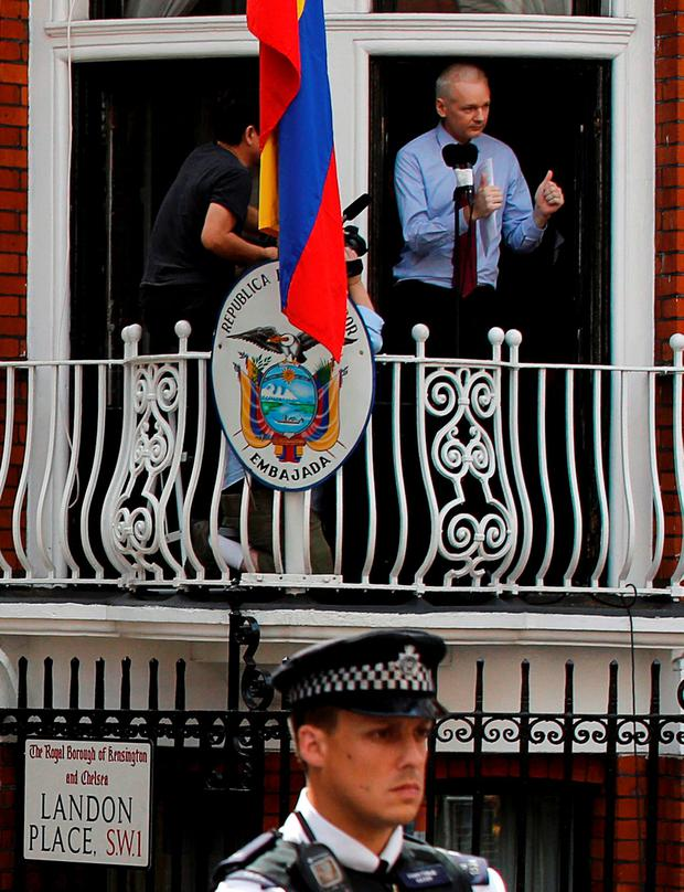 Wikileaks founder Julian Assange gestures as he speaks from the balcony of Ecuador's embassy