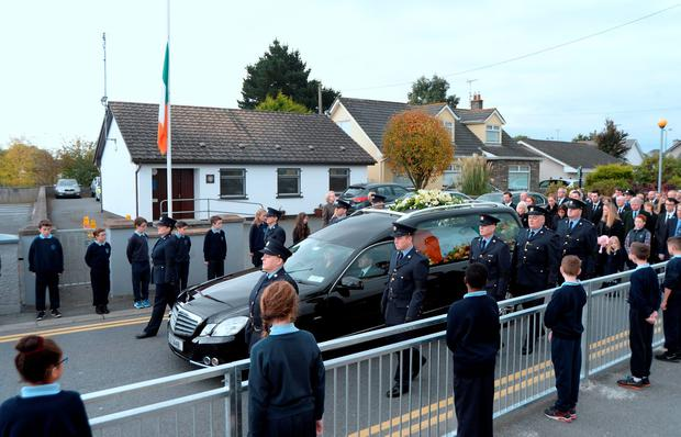 Hearse passes Blackrock garda station. Picture: Caroline Quinn