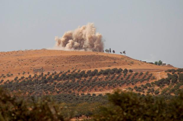Smoke rises after what activists said were air strikes carried out by the Russian air force on Talat al-Sayyad, in the northern countryside of Hama, Syria October 14, 2015