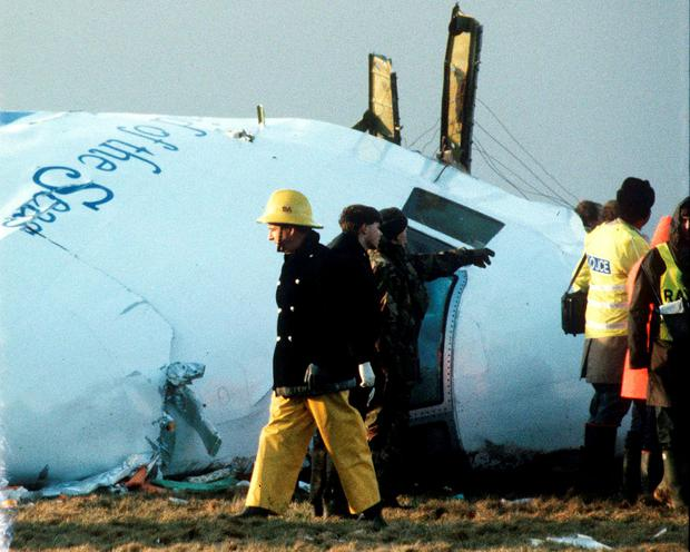 Scottish rescue workers and crash investigators search the area around the cockpit of Pan Am flight 103 in a farmer's field east of Lockerbie, Scotland Credit: Greg Bos