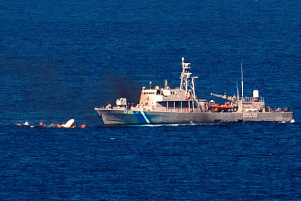 Eight migrants are missing near the Greek island of Lesbos after their boat collided with a Greek rescue vessel Credit: DIMITAR DILKOFF (Getty Images)