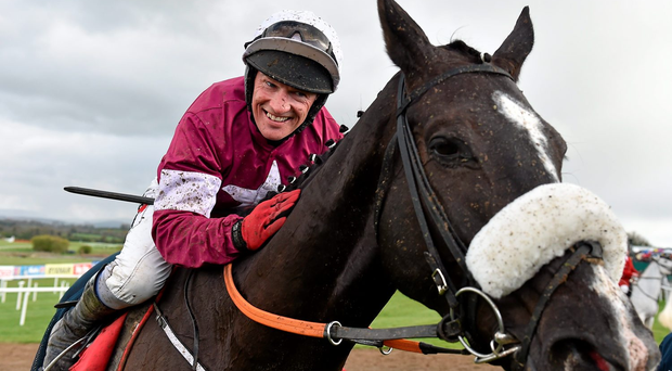 Don Cossack and Jockey Paul Carberry after victory in the Bibby Financial Services Ireland Punchestown Gold Cup in April