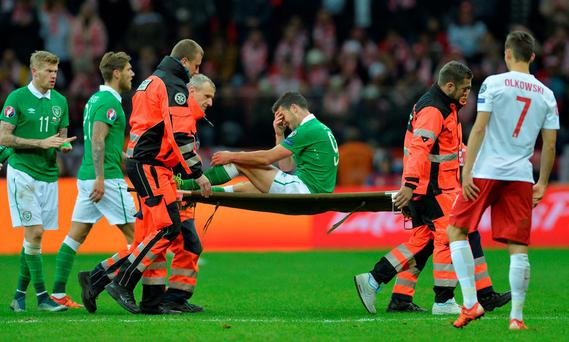 Ireland's Shane Long is stretchered off after sustaining an injury in the defeat to Poland.