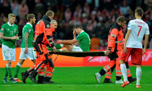 Ireland's Shane Long is stretchered off after sustaining an injury