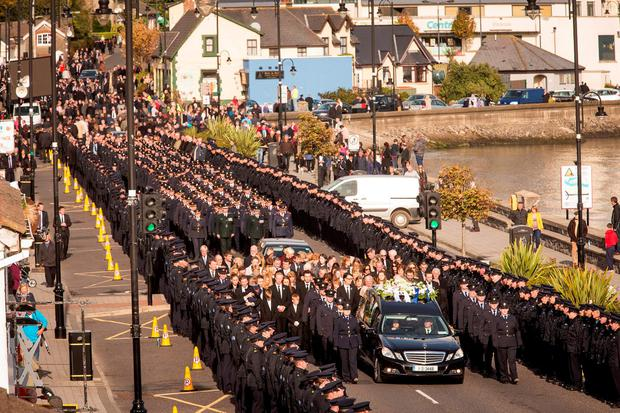 Gardai line the route as the cortege makes its way through Blackrock