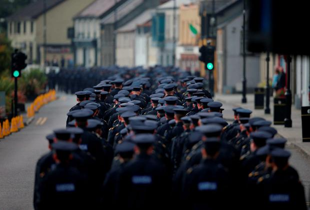 The funeral procession of Garda Tony Golden passes through Blackrock village on its way to St Oliver Plunkett Church, Blackrock in Co Louth, for his state funeral
