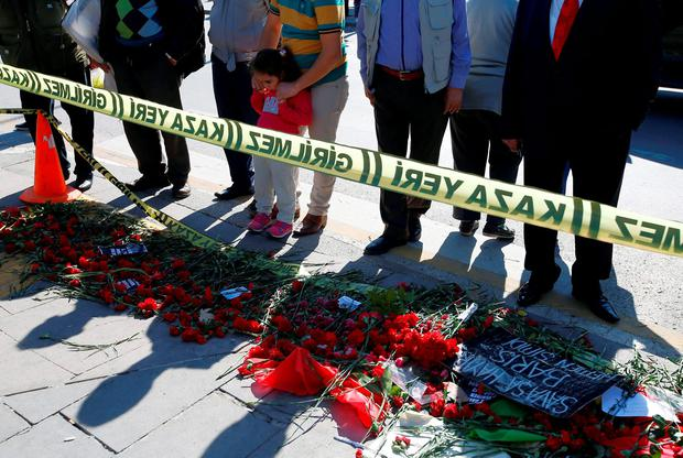 People look at the site of deadly Saturday explosions in Ankara, Turkey, Wednesday, Oct. 14, 2015. (AP Photo/Emrah Gurel)