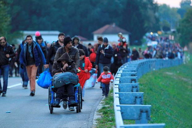 Migrants walk to the border with Hungary after arriving by train at Botovo, Croatia Credit: Antonio Bronic (REUTERS)