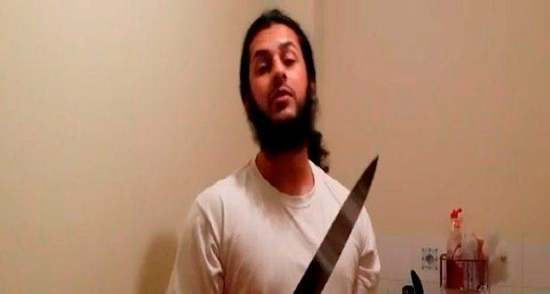 Undated Metropolitan Police handout of a still taken from a video of Haseeb Hamayoon brandishing a knife, which was shown to the jury at London's Woolwich Crown Court, where he is accused of plotting a terror attack around Remembrance Day last year along with Yousaf Syed, 20, and 22 year-old Nadir Syed