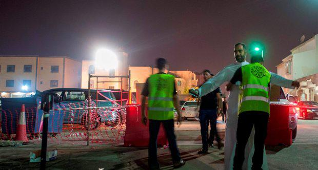 Saudi Shiite worshipers are frisked by members of security as they make their way to a hussainiya, a Shiite hall used for commemorations, in the mainly Shiite coastal town of Qatif, 400 kms east of Riyadh, on October 16, 2015, two days after the start of commemorations of Ashura, one of the holiest occasions for the Shiite faith, a minority in Sunni-dominated Saudi Arabia. A gunman opened fire at a Shiite gathering in eastern Saudi Arabia, wounding four people before being killed himself, state TV said