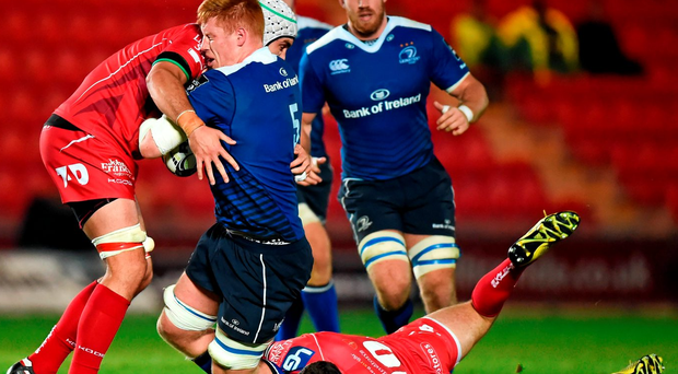 Lesinter's Tom Denton is tackled by Tom Price, left, and Steve Shingler of Scarlets