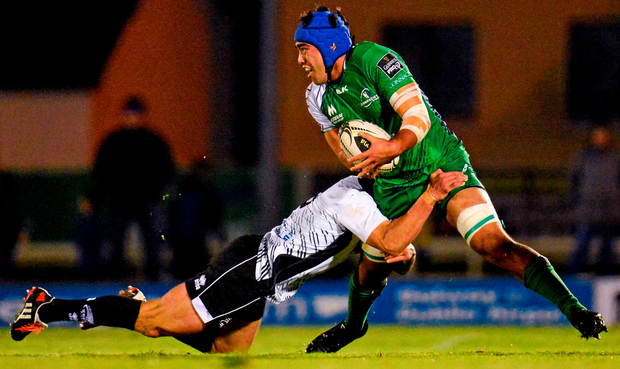 Nepia Fox-Matamua of Connacht is tackled by Tommaso Boni