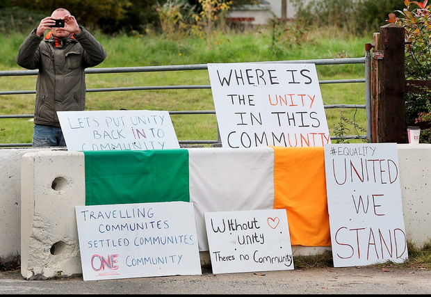 A pro-halting site protester at the entrance to the proposed site at Rockville Drive in Carrickmines, Dublin