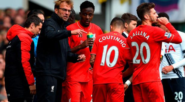 Jurgen Klopp, manager of Liverpool instructs his players during the Barclays Premier League match between Tottenham Hotspur and Liverpool at White Hart Lane
