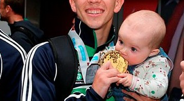 Michael Conlan's daughter Luisne takes a shine to his world title medal