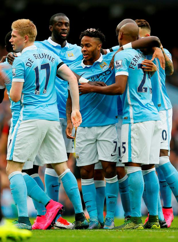Football - Manchester City v AFC Bournemouth - Barclays Premier League - Etihad Stadium - 17/10/15 Manchester City's Raheem Sterling celebrates scoring their first goal with teammates Action Images via Reuters / Jason Cairnduff Livepic EDITORIAL USE ONLY. No use with unauthorized audio, video, data, fixture lists, club/league logos or