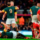 South Africa's flanker Schalk Burger (C-R) hugs South Africa's scrum half and captain Fourie du Preez (C-L) after winning a quarter final match of the 2015 Rugby World Cup between South Africa and Wales at Twickenham