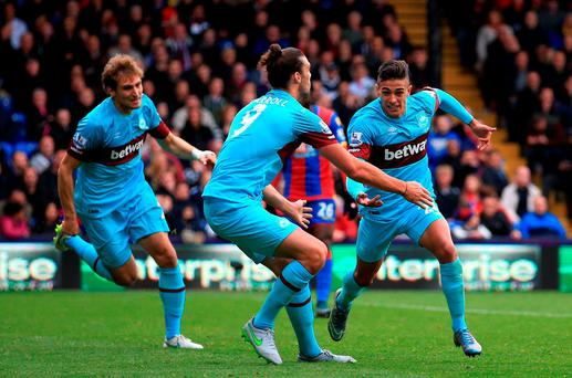 West Ham United's Manuel Lanzini (right) celebrates scoring his side's second goal of the game with teammate Andy Carroll (centre)