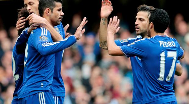 Chelsea's Diego Costa, Cesc Fabregas and pedro celerbate after Aston Villa's Alan Hutton (not pictured) scores an own goal and Chelsea's second Reuters / Suzanne Plunkett Livepic