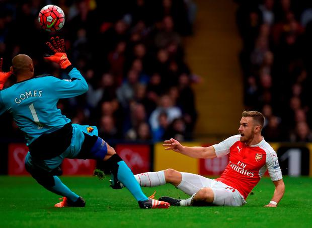 Arsenal's Welsh midfielder Aaron Ramsey (R) shoots over Watford's Brazilian goalkeeper Heurelho Gomes but misses the goal during the English Premier League football match between Watford and Arsenal at Vicarage Road Stadium in Watford, north of London on October 17, 2015. AFP PHOTO / PAUL ELLIS RESTRICTED TO EDITORIAL USE. No use with unauthorized audio, video, data, fixture lists, club/league logos or 'live' services. Online in-match use limited to 75 images, no video emulation. No use in betting, games or single club/league/player publications.PAUL ELLIS/AFP/Getty Images