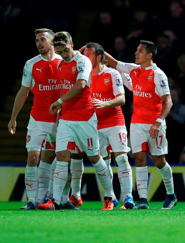 WATFORD, ENGLAND - OCTOBER 17: Alexis Sanchez of Arsenal (R) celebrates with team mates as he scores their first goal during the Barclays Premier League match between Watford and Arsenal at Vicarage Road on October 17, 2015 in Watford, England. (Photo by Jan Kruger/Getty Images)