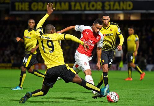 Watford's Victor Ibarbo tries to stop the advance of Francis Coquelin