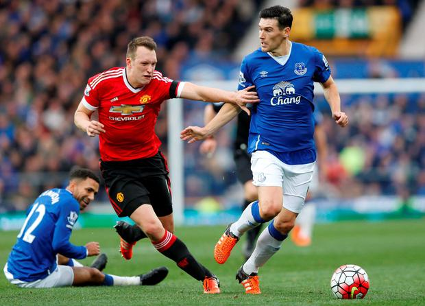 Man United's Phil Jones tries to reach the ball