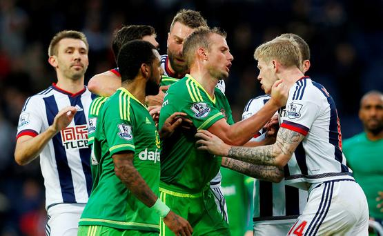 James McClean of West Brom is grappled by Sunderland's Lee Cattermole after his celebration