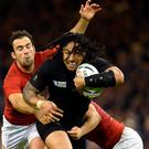 New Zealand's Ma'a Nonu in action against France's Morgan Parra. Photo: Reuters
