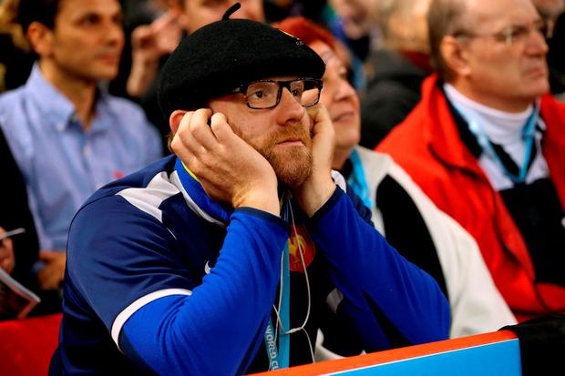 A France fan appears dejected in the stands during the game. Photo: PA
