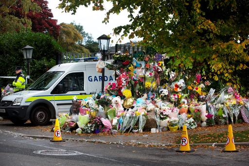 TRIBUTES: Flowers cover the entrance to tragic halting site