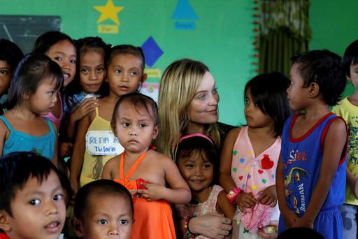 GIRL POWER: Laura chats to the local island children