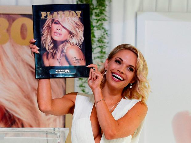 ALL AMERICAN SMILE: Dani Mathers, the 2015 Playmate of the Year, holds a plaque with the cover of the June 2015 'Playboy' issue at the Playboy Mansion in Los Angeles, California