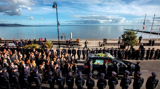 STATE FUNERAL: Over 4,500 officers follow the remains of colleague Garda Tony Golden after his funeral in Blackrock, Co Louth. Photo: Mark Condren