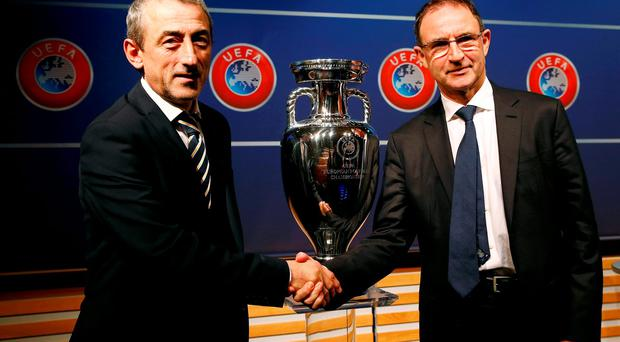Ireland's coach Martin O'Neill (R) shakes hand with Bosnia and Herzegovina's coach Mehmed Bazdarevic after the draw for the play-off matches
