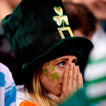 A dejected Ireland fan in the stands during the Rugby World Cup match at the Millennium Stadium, Cardiff.