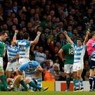 Argentina's back row forward Facundo Isa (2nd L) and Argentina's wing Santiago Cordero (2nd R) celebrate at the final whistle of a quarter final match of the 2015 Rugby World Cup between Ireland and Argentina at the Millennium Stadium in Cardiff, south Wales, on October 18, 2015. AFP PHOTO / LOIC VENANCE