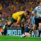 Australia's wing Drew Mitchell scores his team's second try during a quarter final match of the 2015 Rugby World Cup between Australia and Scotland at Twickenham stadium, southwest London on October 18, 2015. AFP PHOTO / GLYN KIRK RESTRICTED TO EDITORIAL USE, NO USE IN LIVE MATCH TRACKING SERVICES, TO BE USED AS NON-SEQUENTIAL STILLSGLYN KIRK/AFP/Getty Images