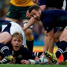 Scotland's scrum half and captain Greig Laidlaw (R) passes the ball during a quarter final match of the 2015 Rugby World Cup between Australia and Scotland at Twickenham stadium, southwest London on October 18, 2015. AFP PHOTO / ADRIAN DENNIS RESTRICTED TO EDITORIAL USE, NO USE IN LIVE MATCH TRACKING SERVICES, TO BE USED AS NON-SEQUENTIAL STILLSADRIAN DENNIS/AFP/Getty Images