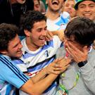 Argentina head coach Daniel Hourcade celebrates with fans following the Rugby World Cup match at the Millennium Stadium