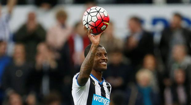 Newcastle United's Georginio Wijnaldum celebrates with the match ball after the game after scoring four goals