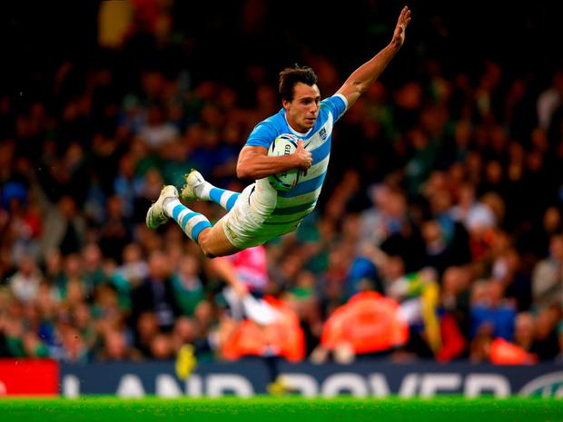 Argentina's Juan Imhoff dives over the line in celebration as he rounds off the victory against Ireland in fine style